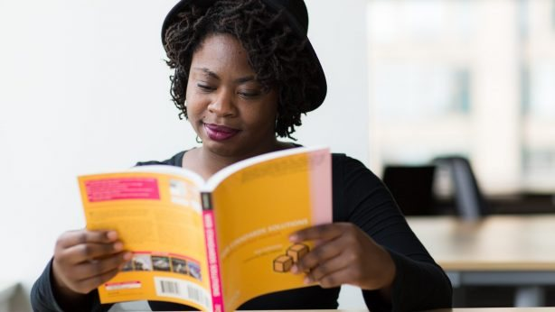 Canva - Woman in Black Long-sleeved Shirt Reading a Yellow Covered Book